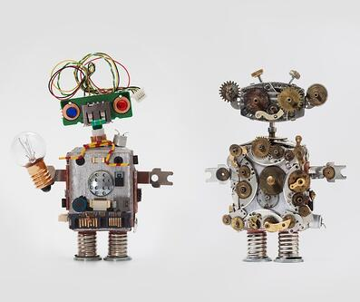 futuristic-robots-on-gray-background-friendly-mechanical-toys-with-picture-id655105682